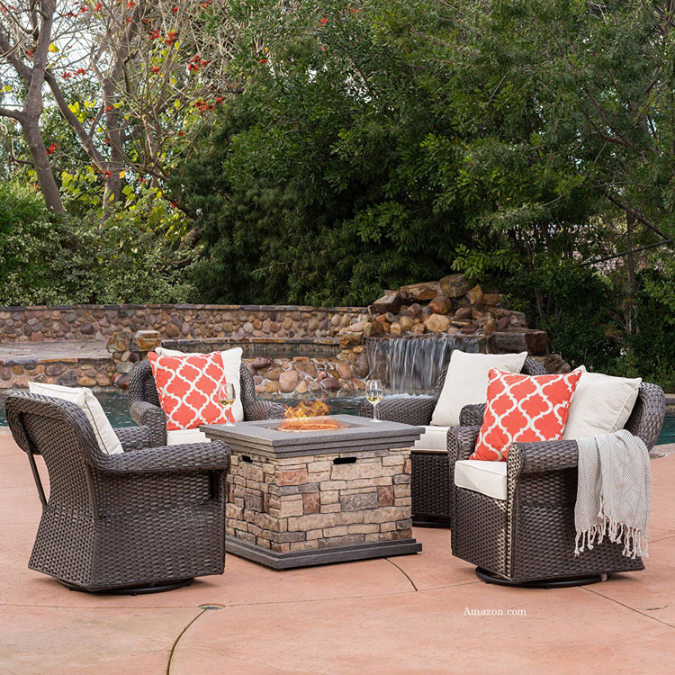 wicker rocking chair set with fireplace on patio