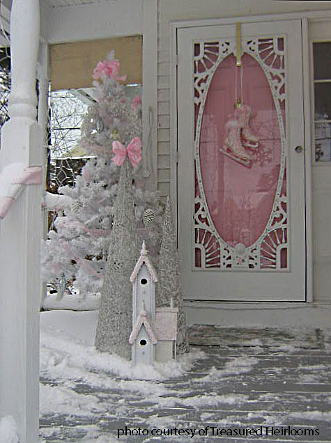 winter front porch with pink door and ice skates