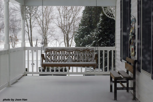 winter porch swing waiting for spring