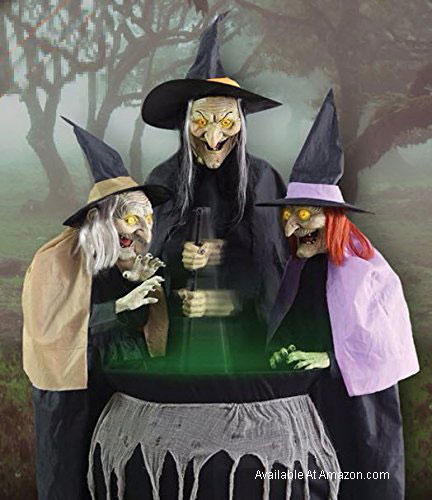 three witches at caldron for halloween