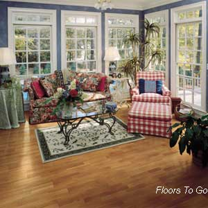 wood flooring in decorated sunroom