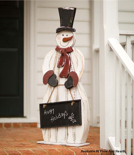 wood snowman holding a chalkboard for front porch Christmas decoration