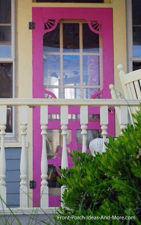 colorful wooden screen door on front porch