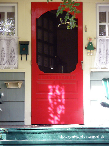 red wooden screen door