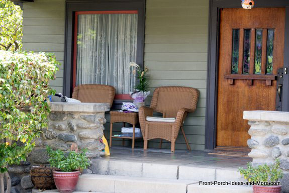 craftsman style wooden front door on porch
