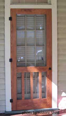 stained screen door by historic shed