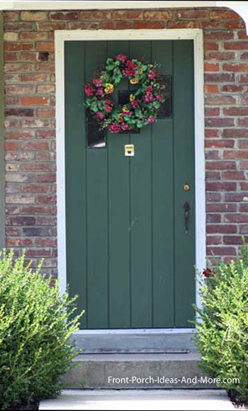 decorative front door wreath on green door