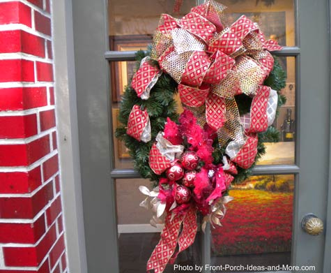 Beautiful Christmas wreath with red holiday ribbon