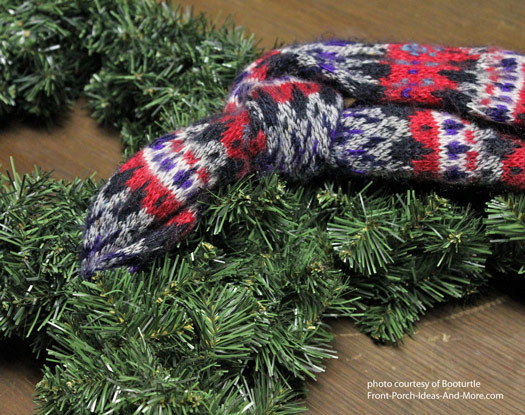 attaching a scarf to christmas wreath