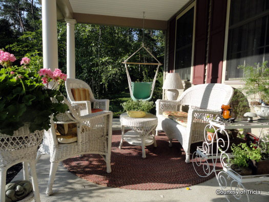 front porch with wicker furniture and colorful decorations