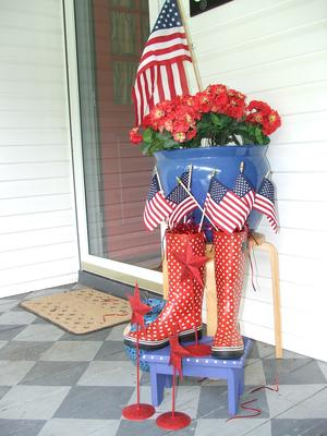 Beth's Patriotic porch decorations - red polka dot boots and flags make a nice ensemble