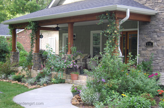 Whimsical porch landscaping by Flowergardengirl
