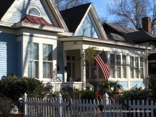 quaint front porch with American flag