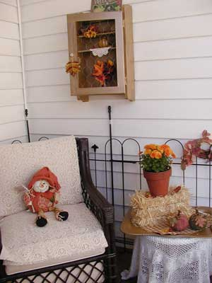 autumn decorated chair with whimiscal folklore piece