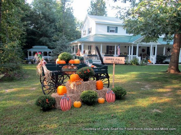 yard display with wagon and autumn decorations