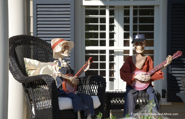 skeletons playing banjos on the front porch