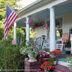 bed and breakfast front porch with foliage