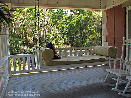 Serene Scene Of Bed Swing On Front Porch