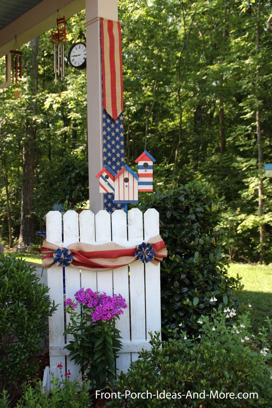 patriotic birdhouses on decorative picket fence