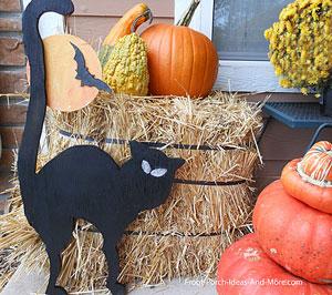black cat, moon, and bat
