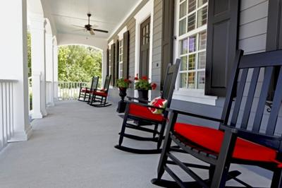 Black rockers with red cushions at Tucker Hill, McKinney TX