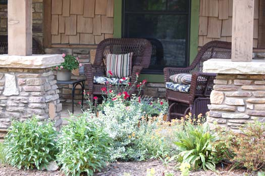 pleasant landscaping in front of porch