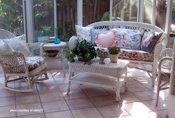 cozy furniture in sunroom with tile floor