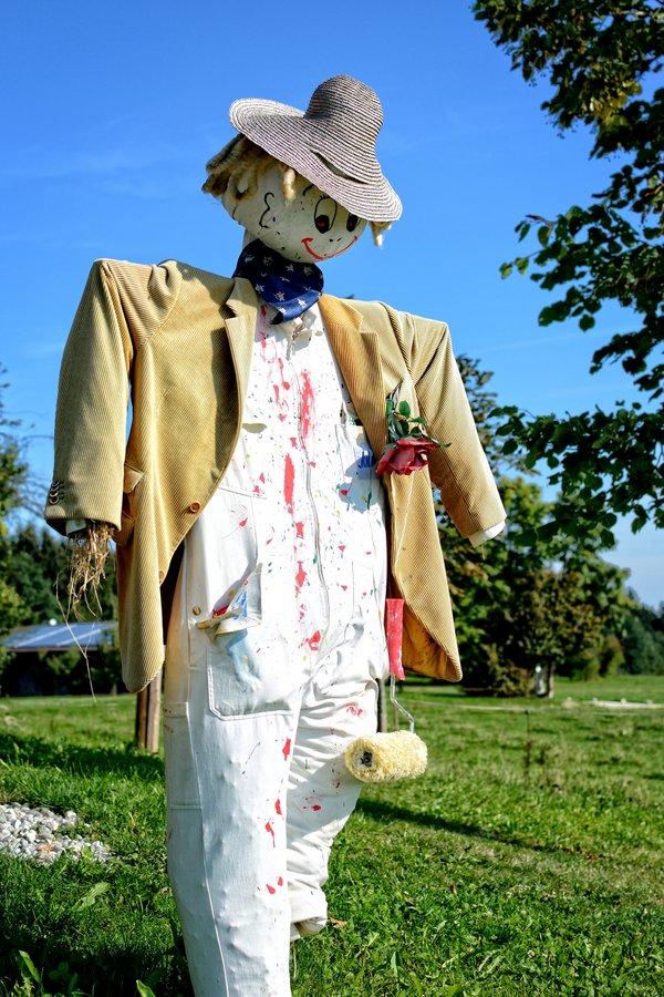Happy painter scarecrow