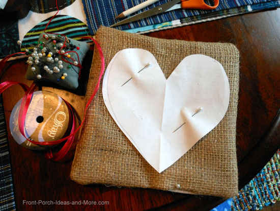 To make the heart shape onto the burlap pillow I used a paper heart as a template