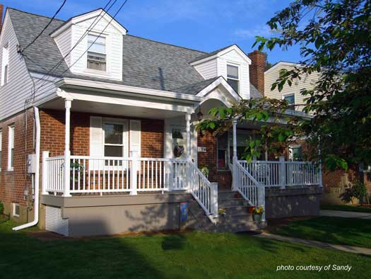 Sandy's Cape Cod house with a new porch - what a wonderful transformation. Get front porch ideas on www.front-porch-ideas-and-more.com