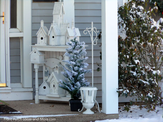 Winter beauty - snowy porch decorated with a vignette of birdhouses