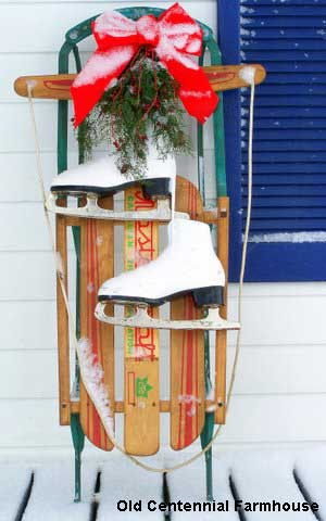 Outside Christmas decorations - decorated sled and ice skates - love!