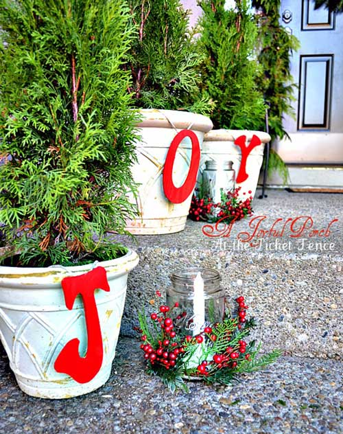 Planters decorated with holiday letters