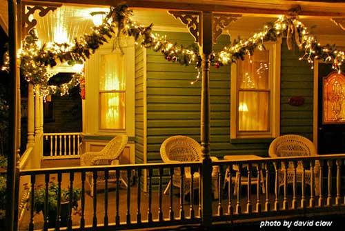 Christmas lights shine on front porch
