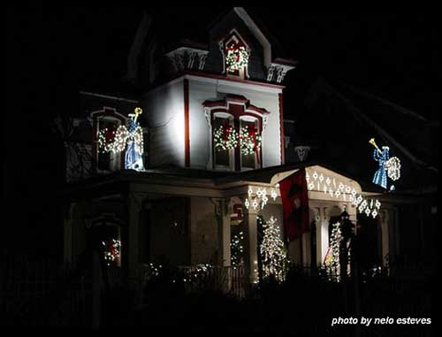 Christmas light idea example - beautiful angels lit up on front of house and 2nd story