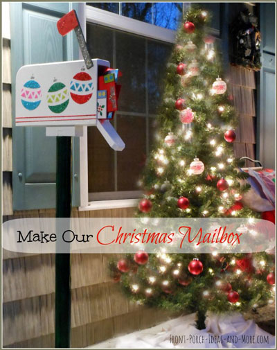 white wooden christmas mailbox with letters on porch