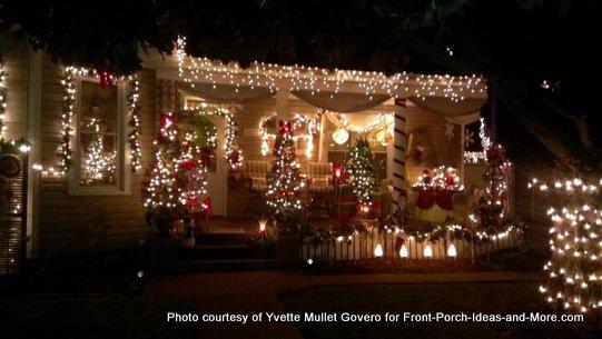 christmas trees adorn porch and yard