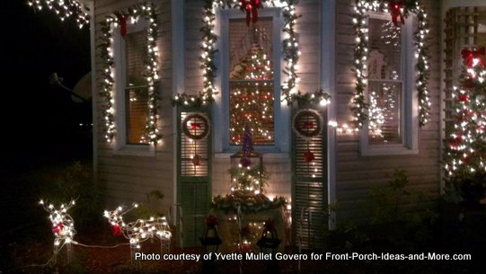 windows framed with holiday lights and garland