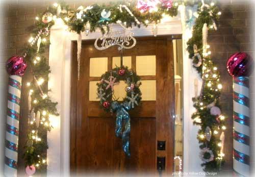 lighted evergreen garland over front door