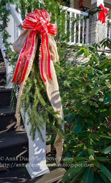 Burlap, red bows and garland grace Anita's porch steps