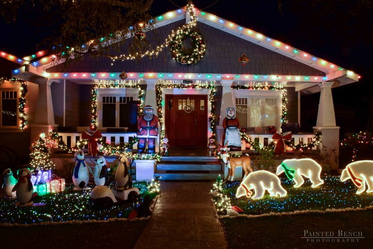 front porch decorated with traditional Christmas lights