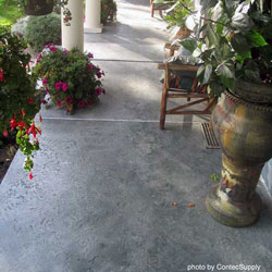 stained concrete porch floor with plants