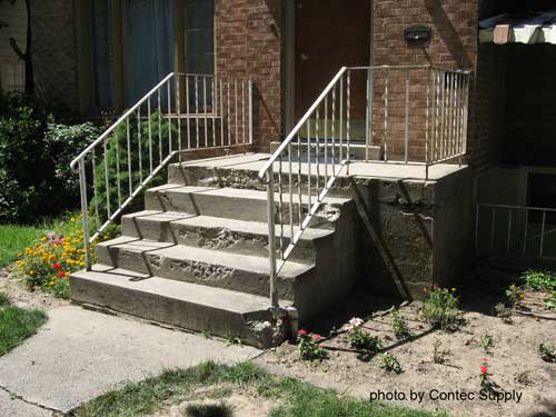 concrete porch steps in need of repair