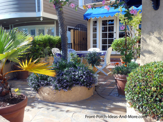 easy to maintain container landscaping with beautiful flowers