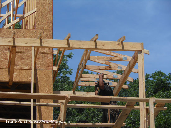view of corner trusses installed over front porch