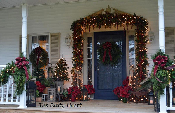 country front porch decorated for christmas