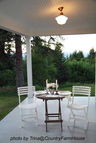bistro table and chairs on country porch