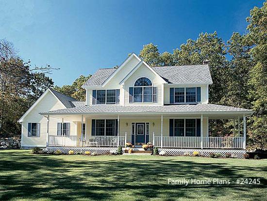 large white farm house with wrap around porch