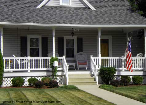 wicker furniture and american flag on front porch