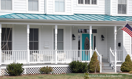wrap around porch with vibrant torquoise front door